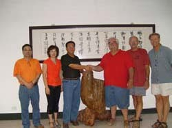 Officials from Shengzhou Stove and Aprovecho Seal the Deal